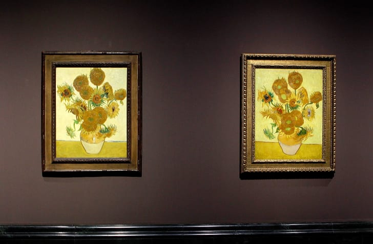 Two of Van Gogh's 'Sunflowers' paintings hanging side by side on display in London