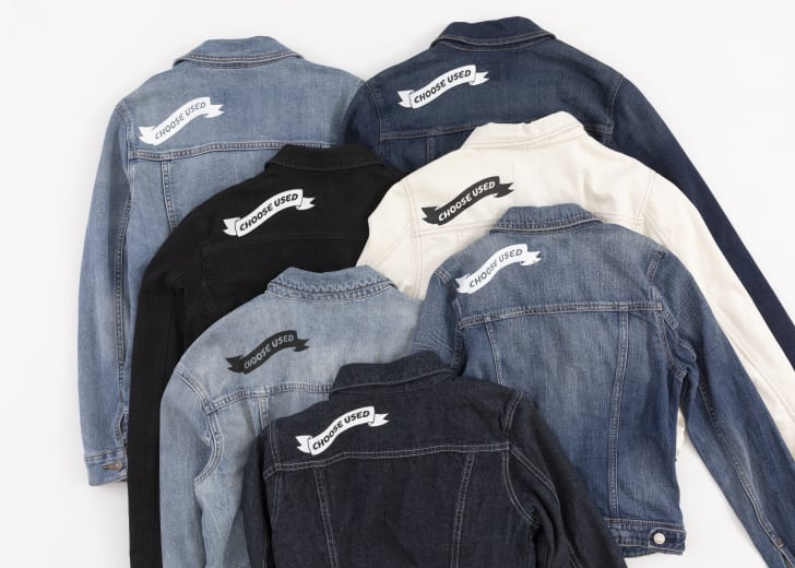 A collection of denim jackets with the screenprinted words 'Choose Used' on them