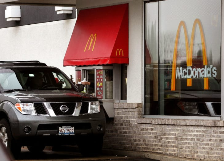 A McDonald's customer pulls up to the drive-thru window