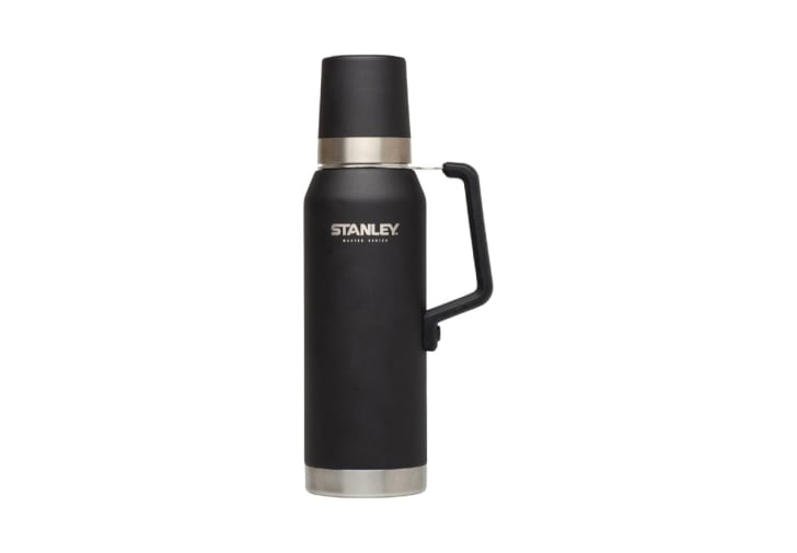 A black Stanley vacuum-insulated bottle