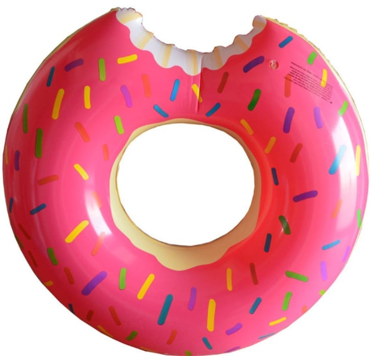 An inflatable pool toy shaped like a pink donut with sprinkles