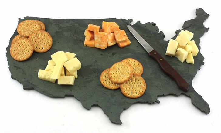 Cheese and crackers arrayed on a slate cheese board