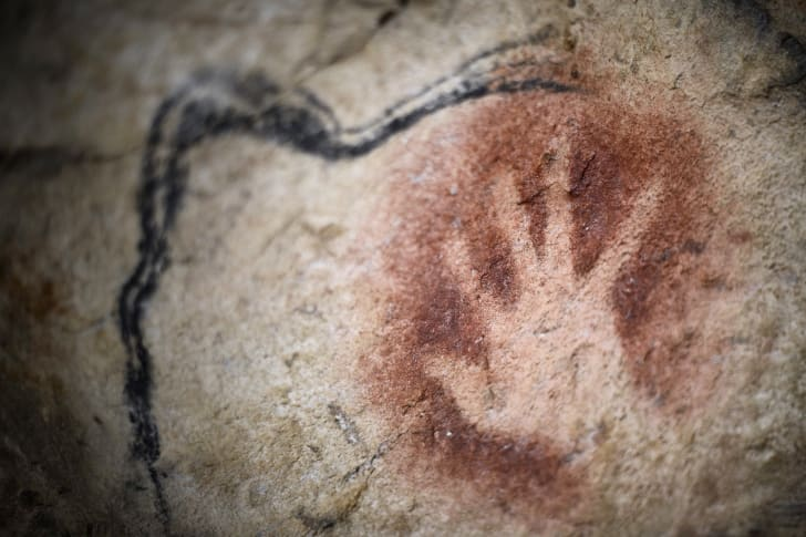A reproduction of a hand stencil found in Chauvet Cave