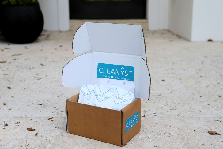 A cardboard box of Cleanyst concentrate packages
