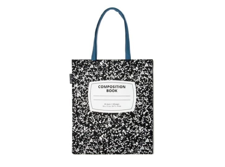 A tote bag that looks like a black-and-white composition notebook