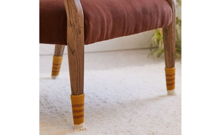 Chair Socks on a living room chair with wooden legs