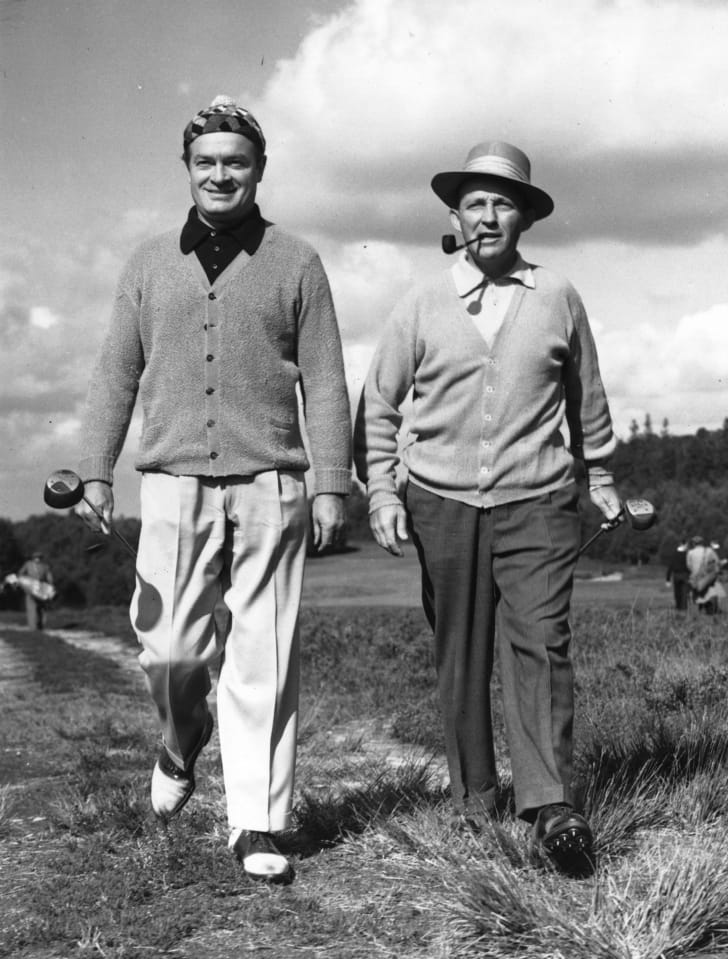 American actor Bob Hope (1903 - 2003) with American singer and actor Bing Crosby (1904 - 1977) practice for a charity golf match at the Berkshire Golf Club, near Ascot