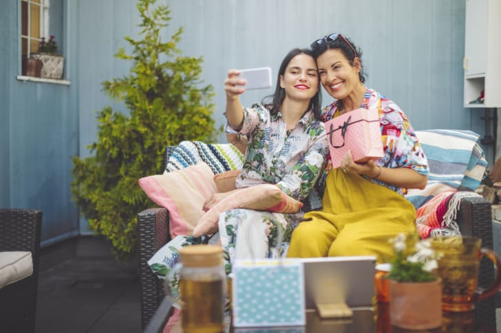 Mother and daughter taking selfies with gifts