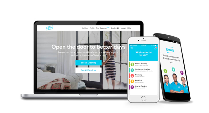 A laptop and a phone open to Handy's homepage