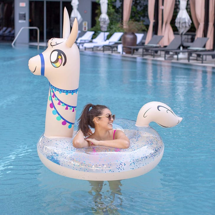 A woman lounges in a llama-shaped pool float