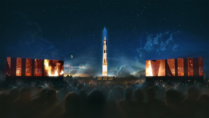 Illustration of the Saturn V rocket projected onto the Washington Monument