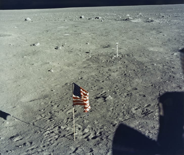 The United States flag is planted on the surface of the Moon by the astronauts of NASA's Apollo 11 lunar landing mission, as seen from inside the Lunar Module the 'Eagle', 20th July 1969