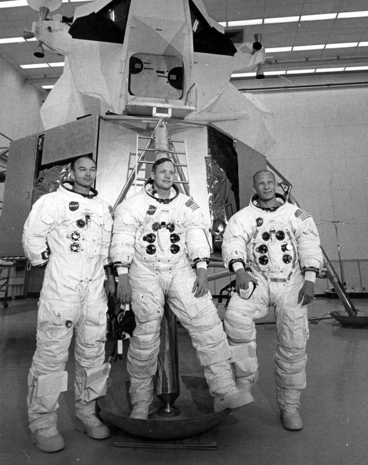 Apollo 11 astronauts Mike Collins (left), Neil Armstrong (centre), and Edwin 'Buzz' Aldrin, in front of the Lunar Landing Module Simulator at the Kennedy Space Centre, USA, prior to their landing on the moon