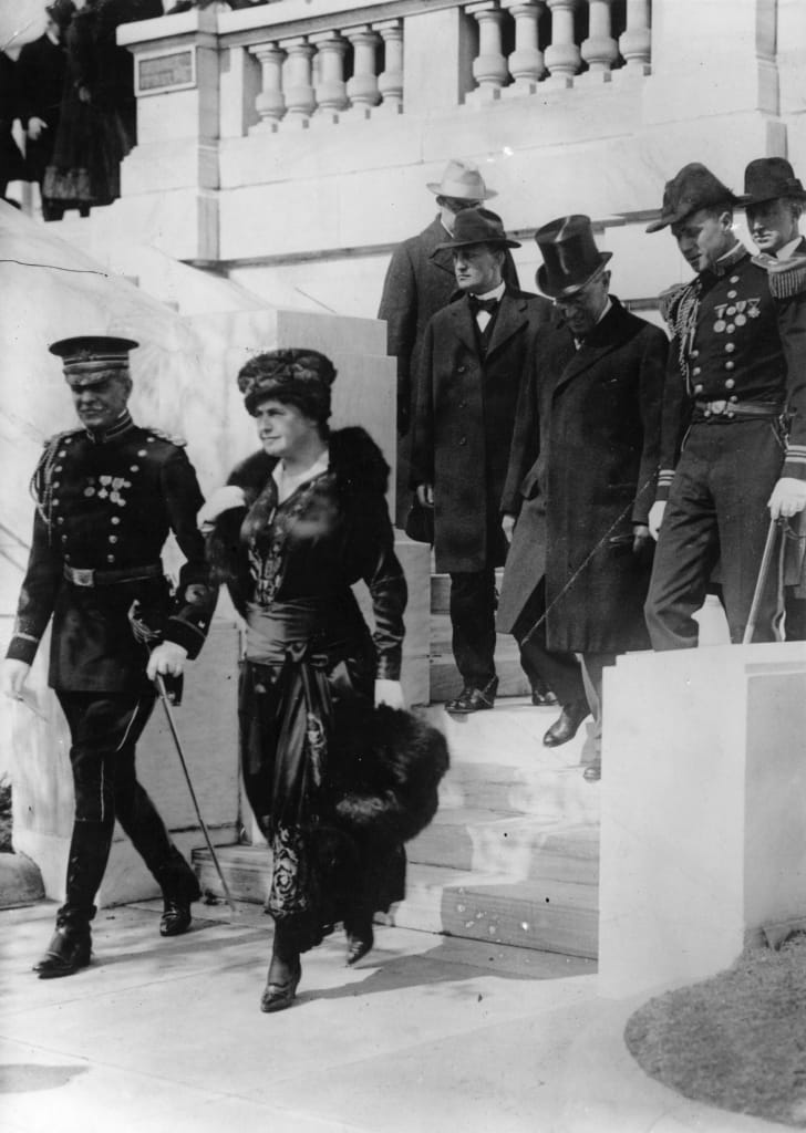 President Woodrow Wilson and his wife Edith with a secret service escort in 1917.