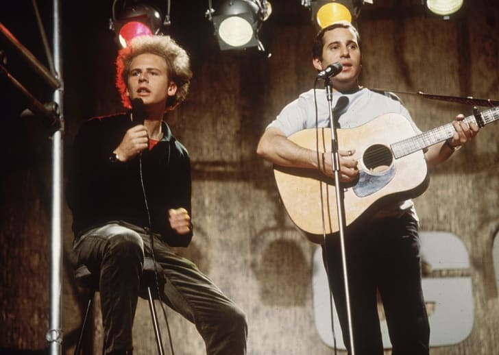 Pop duo Simon and Garfunkel, comprising (L-R) singer, Art Garfunkel and singer-songwriter, Paul Simon, performing on ITV's 'Ready, Steady, Go!', July 8, 1966