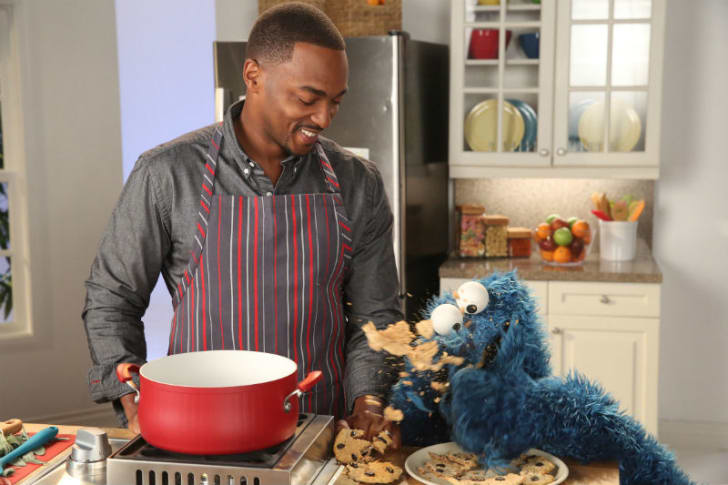 Actor Anthony Mackie appears on 'Sesame Street' with Cookie Monster