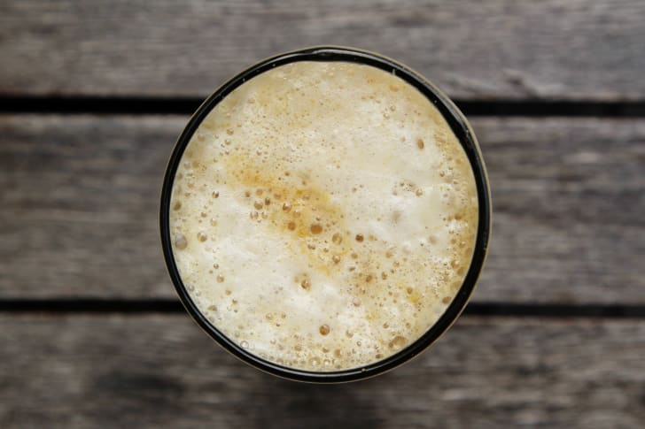 Overhead shot of the foam in a glass of beer