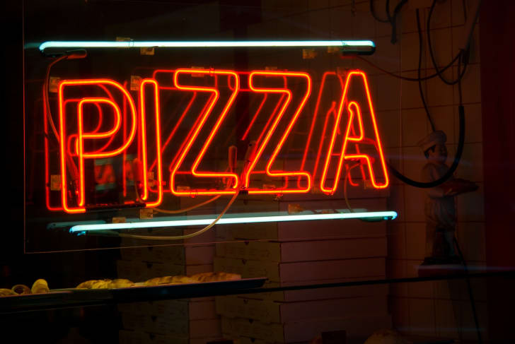 Neon Pizza sign in New York City pizza store
