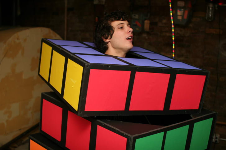 A man dressed up in a Rubik's Cube Halloween costume