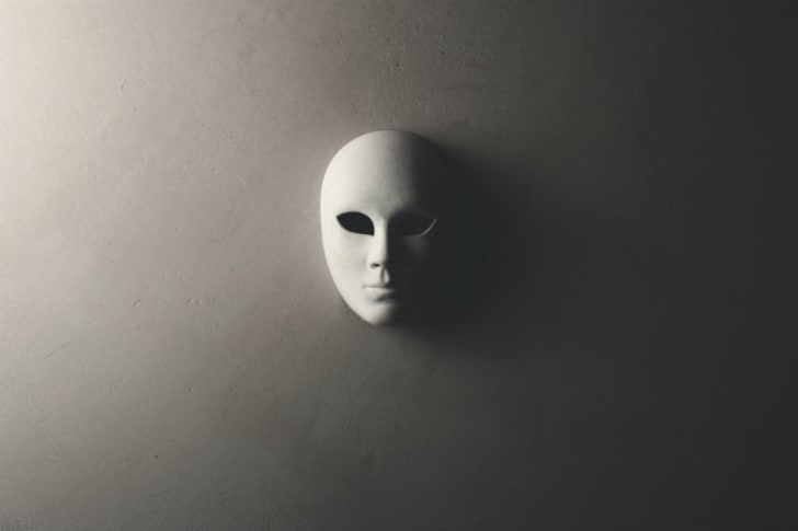 A white mask is pictured