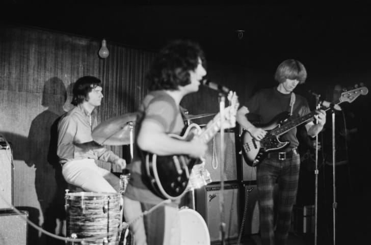 American rock band The Grateful Dead in concert, circa 1970. From left to right, drummer Bill Kreutzmann, lead singer Jerry Garcia and bassist Phil Lesh