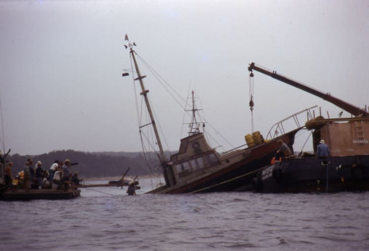 The 'Orca II' is seen sinking during the filming of 'Jaws' in 1974