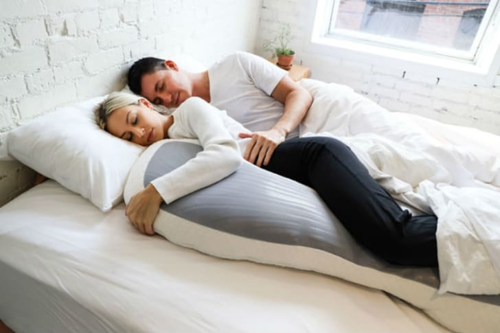 Two models are pictured with the Clone Pillow