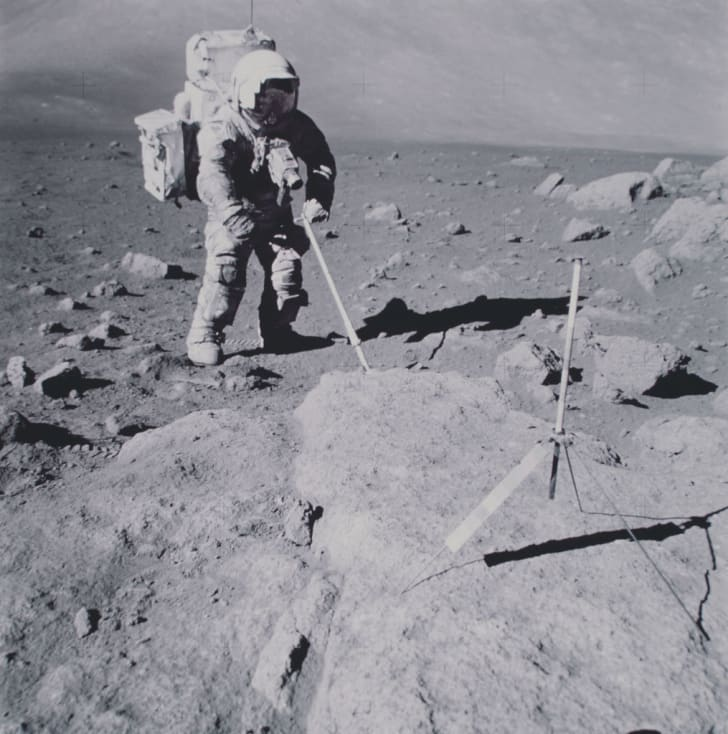 Lunar Module Pilot Harrison H Schmitt collects geological samples on the Moon during his EVA (extravehicular activity) on NASA's Apollo 17 lunar landing mission, 12th December 1972.
