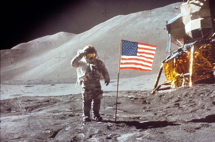 Astronaut David Scott gives salute beside the U.S. flag July 30, 1971 on the moon during the Apollo 15 mission.