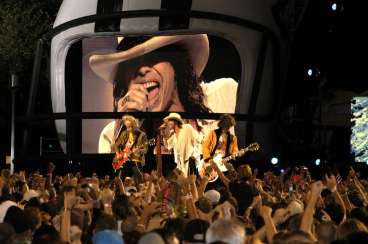 "Aerosmith performs on stage during the Operation Tribute to Freedom, NFL and Pepsi sponsored ""NFL Kickoff Live 2003"" Concert on the Mall"