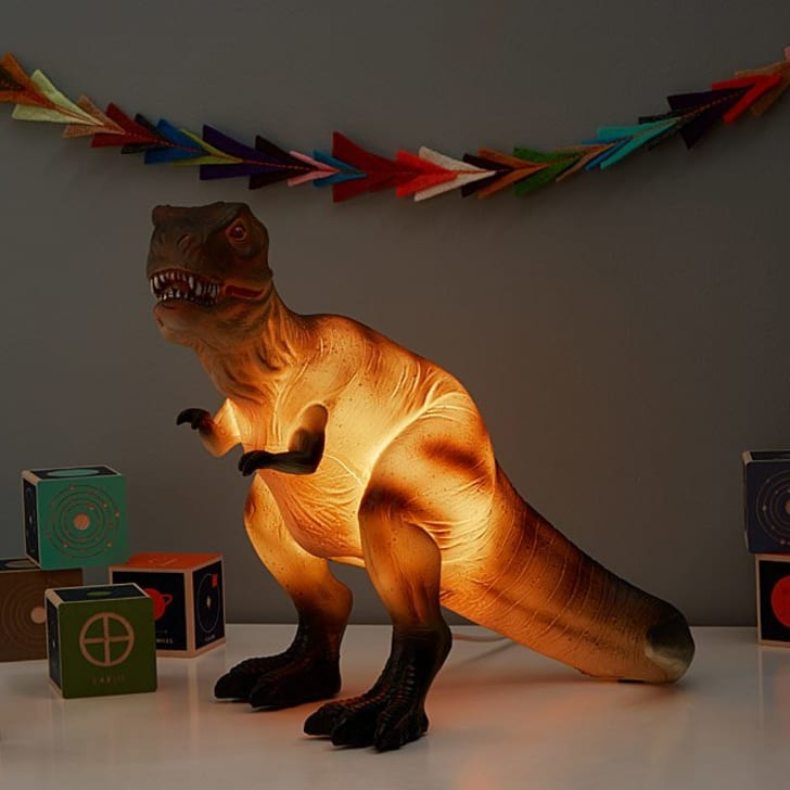 Image of a T-Rex statue glowing from the inside of its midsection.