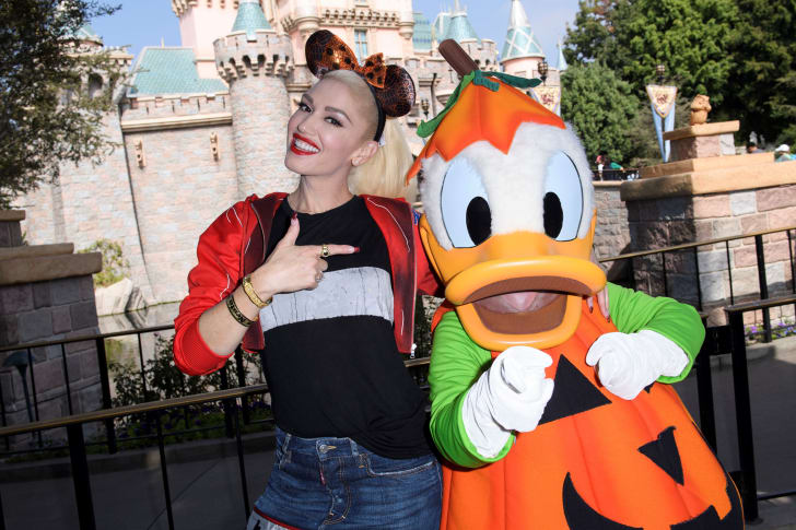 Singer Gwen Stefani poses with Donald Duck