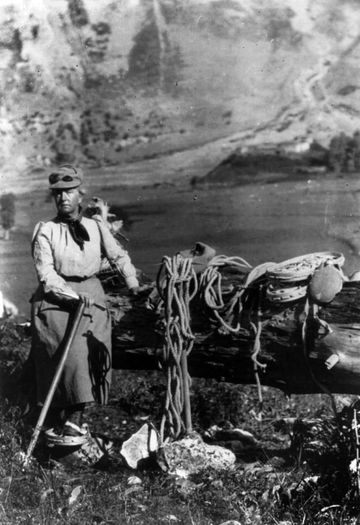 A photo of Fanny Bullock Workman posing while wearing mountain climbing gear.