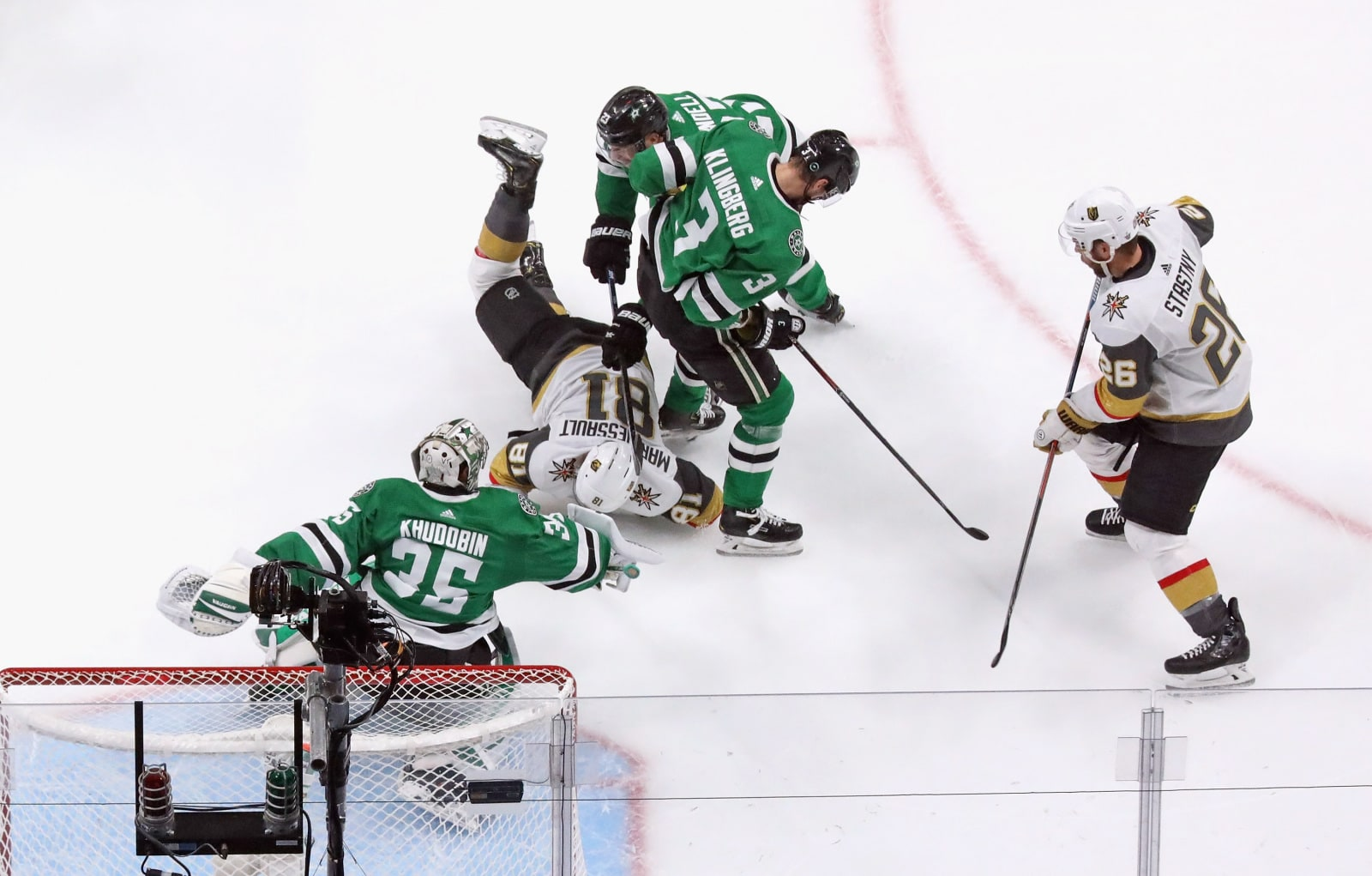 Jonathan Marchessault #81 of the Vegas Golden Knights is tripped up by Esa Lindell #23 of the Dallas Stars in Game Four