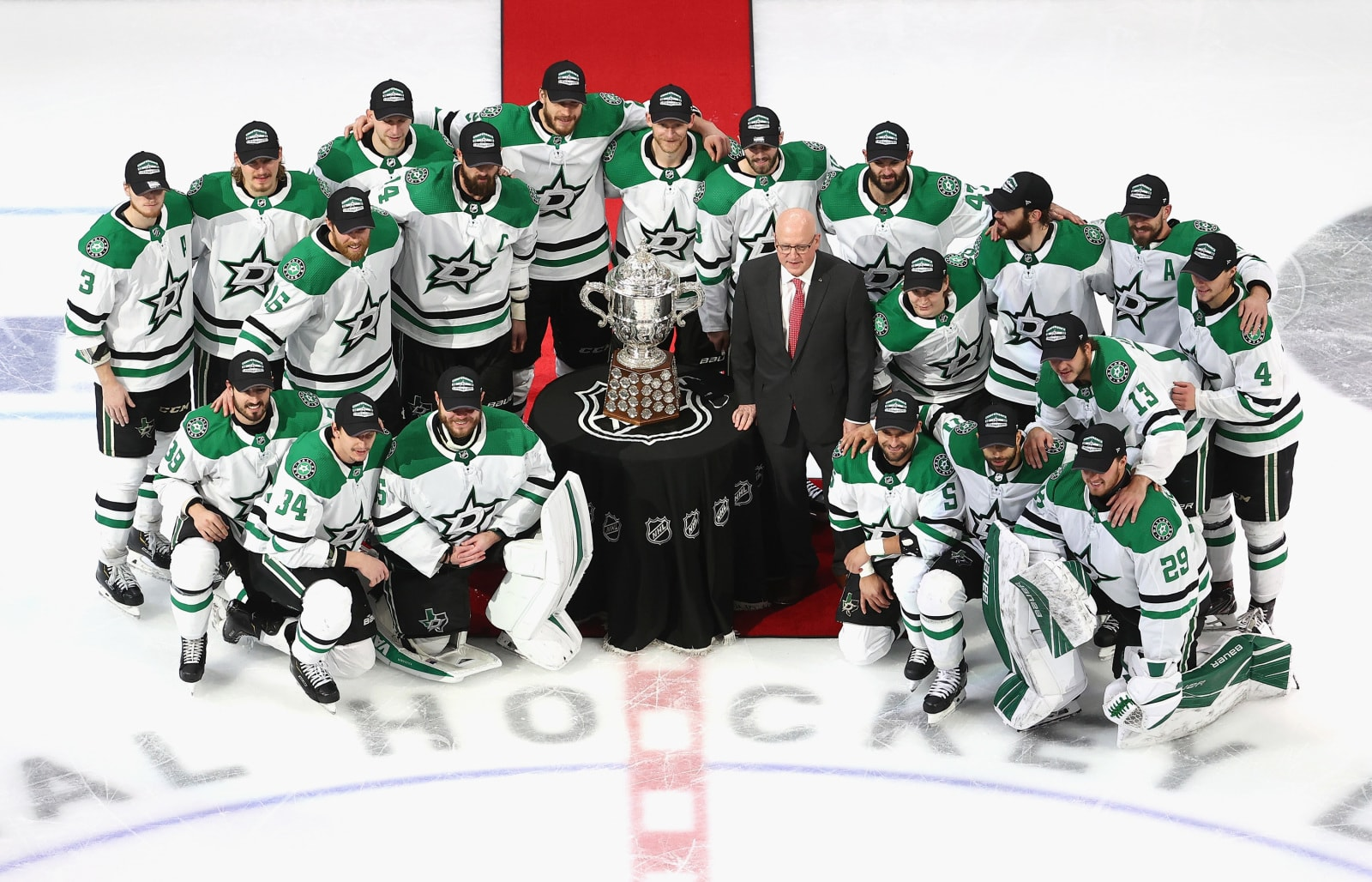 The Dallas Stars pose for a team photo with Bill Daly, the deputy commissioner and chief legal officer of the National Hockey League (NHL) and the Clarence S. Campbell Bowl after winning the Western Conference Championship