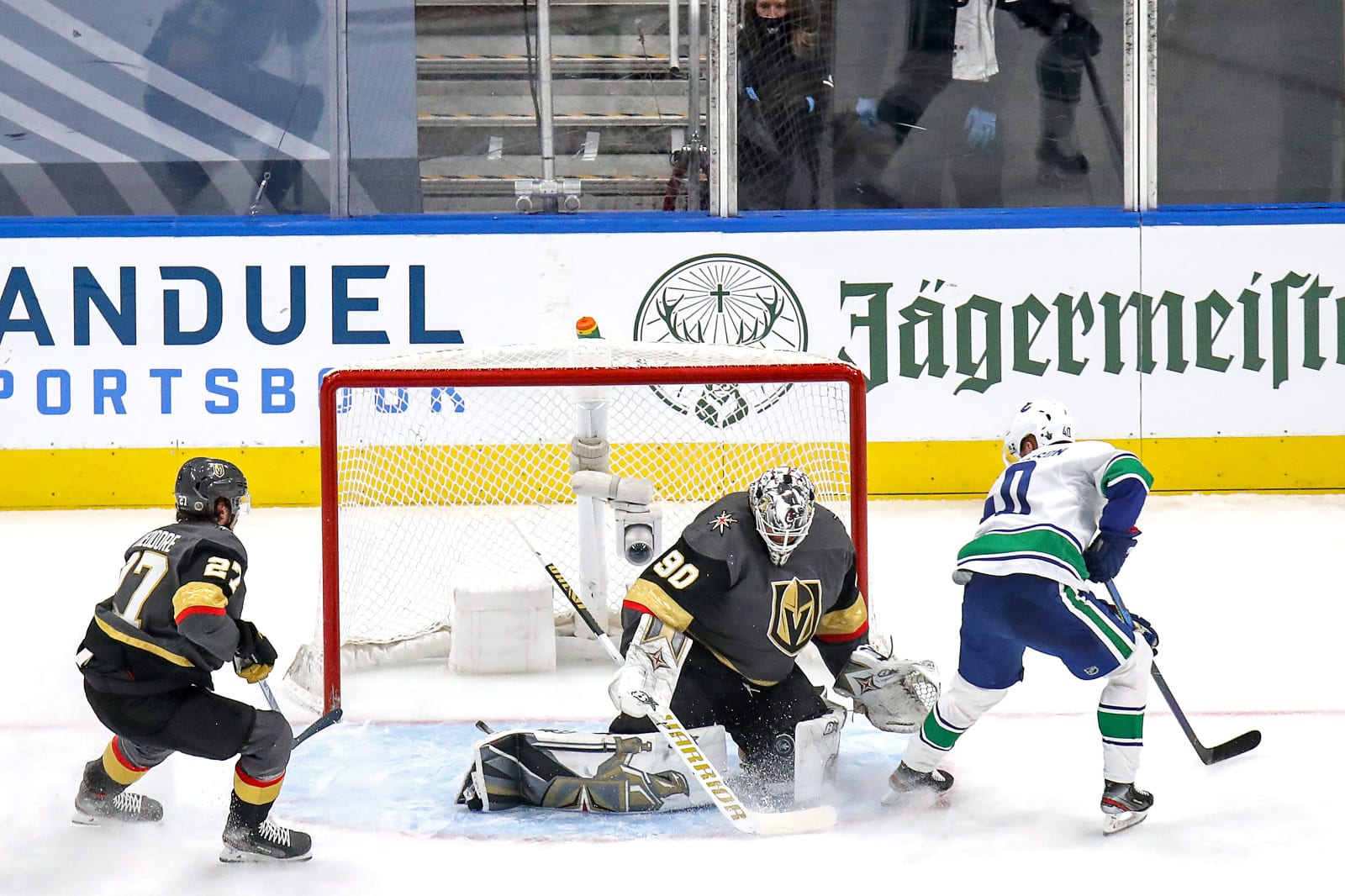Robin Lehner #90 of the Vegas Golden Knights stops a shot against Elias Pettersson #40 of the Vancouver Canucks
