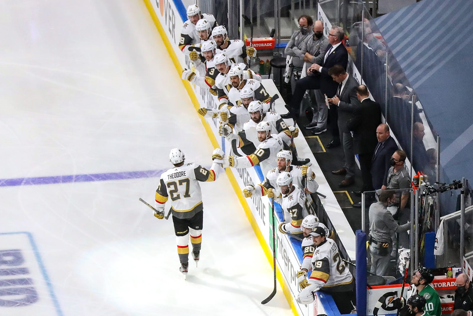 Shea Theodore #27 of the Vegas Golden Knights is congratulated by his teammates after scoring a goal against the Dallas Stars