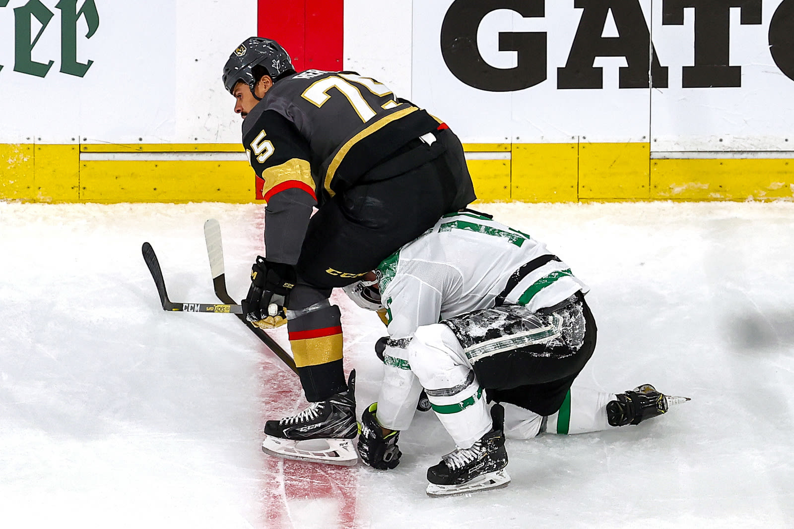 Ryan Reaves #75 of the Vegas Golden Knights scuffles with Blake Comeau #15 of the Dallas Stars after checking him during the first period in Game Five