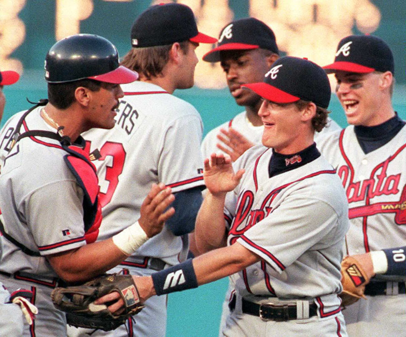 Atlanta Braves' shortstop Jeff Blauser is congratulated by catcher Javy Lopez (L). Blauser hit a two run home run in the game. AFP PHOTO Rhona WISE (Photo credit RHONA WISE/AFP via Getty Images)
