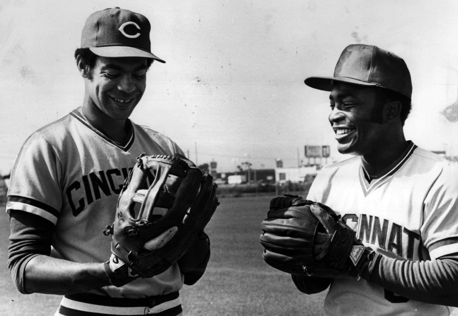 "Joe Morgan, the smallest of the Reds' regulars, compares his small glove to center fielder Cesar Geronimo's ""basket."""