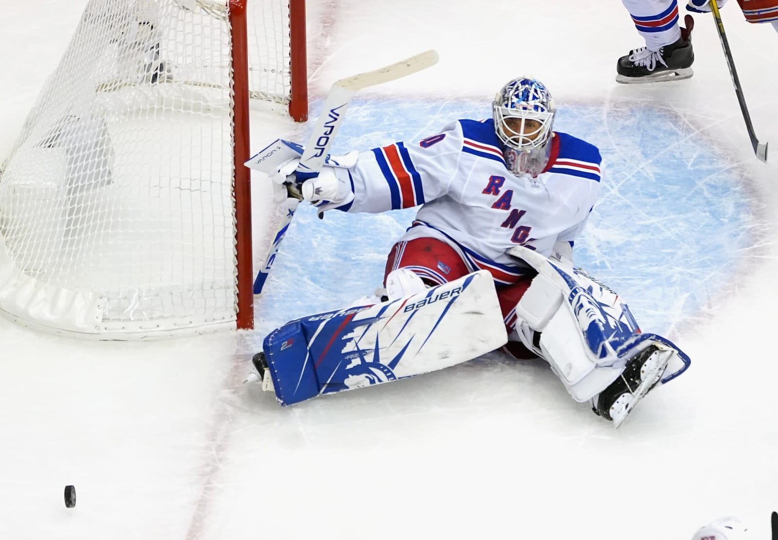 Henrik Lundqvist #30 of the New York Rangers tends net during the third period against the Carolina Hurricanes in Game One of the Eastern Conference Qualification Round.