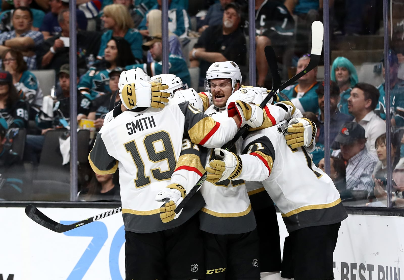William Karlsson #71 of the Vegas Golden Knights is congratulated by teammates.