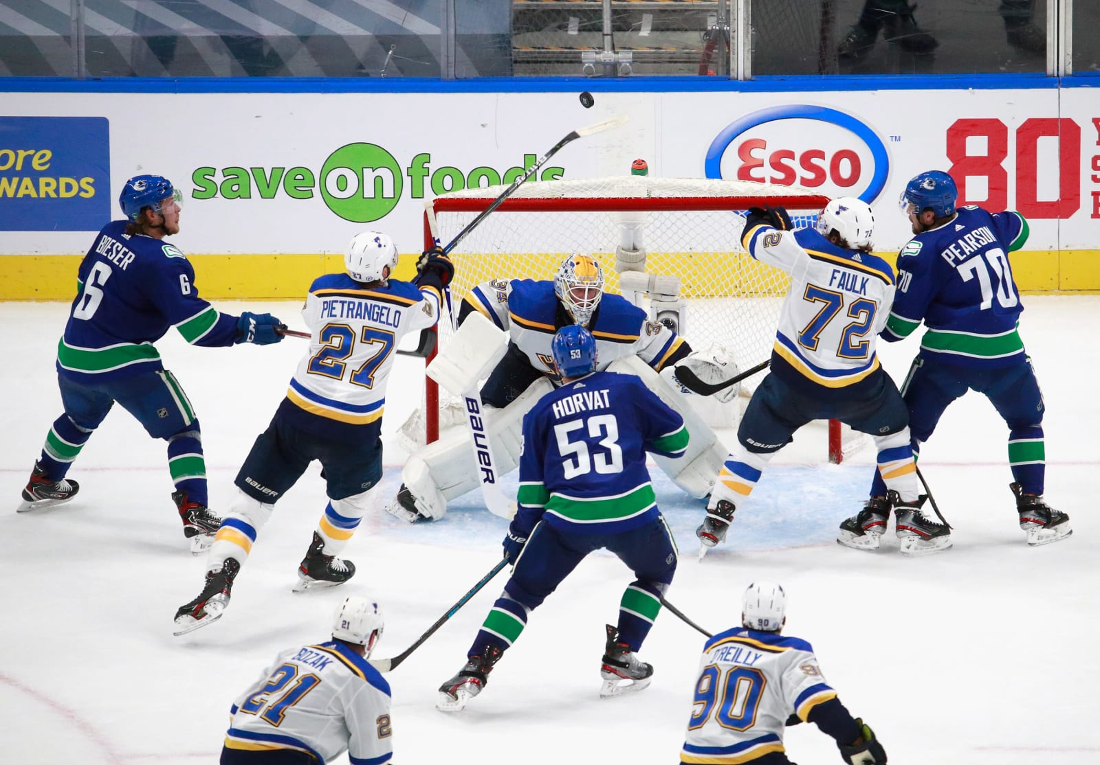 The St. Louis Blues and the Vancouver Canucks battle late in the third period in Game Four