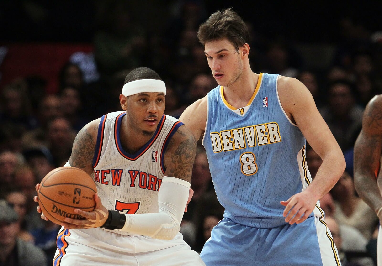 Carmelo Anthony, New York Knicks in action Danilo Gallinari, Denver Nuggets on 21 Jan. 2012 at Madison Square Garden in New York City. (Photo by Jim McIsaac/Getty Images)