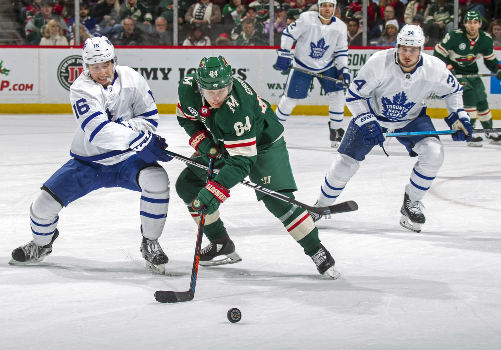 ST. PAUL, MN - DECEMBER 01: Mitch Marner #16 of the Toronto Maple Leafs and Mikael Granlund #64 of the Minnesota Wild battle for the puck during a game at Xcel Energy Center on December 1, 2018 in St. Paul, Minnesota.(Photo by Bruce Kluckhohn/NHLI via Getty Images)