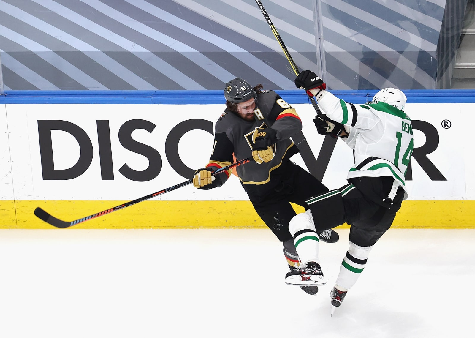 Jamie Benn #14 of the Dallas Stars collides with Mark Stone #61 of the Vegas Golden Knights in Game Two