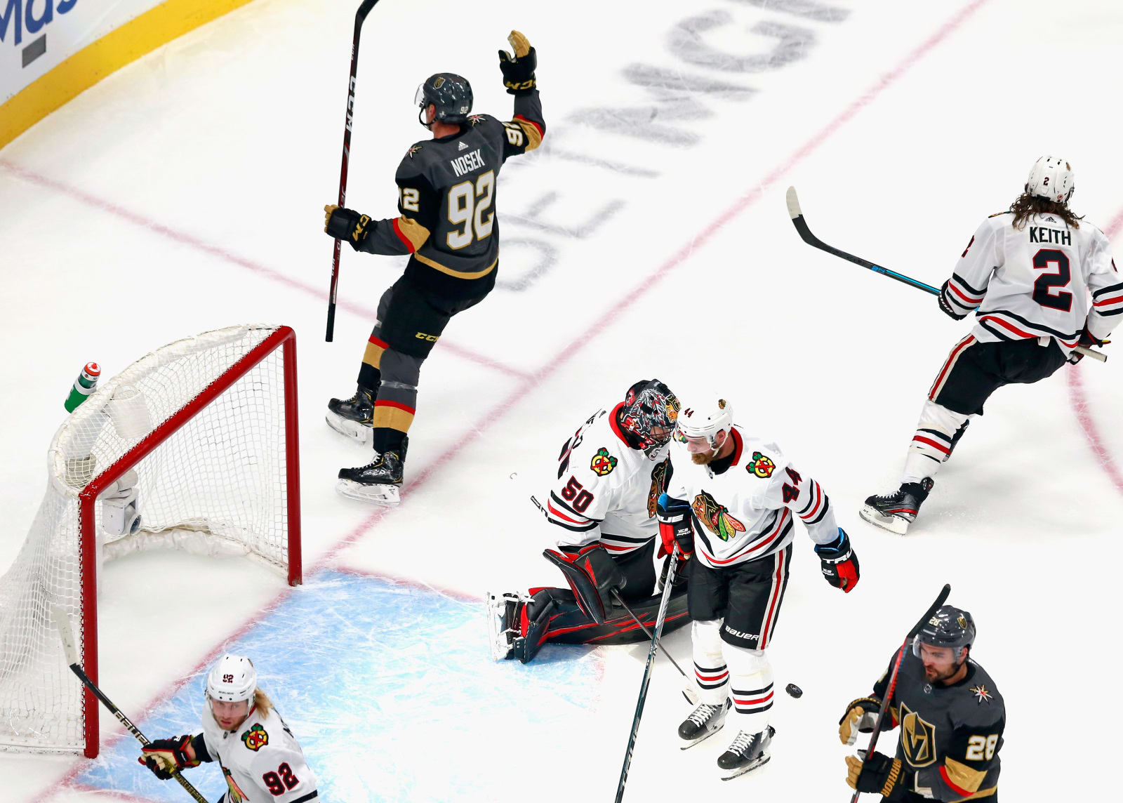 Tomas Nosek #92 of the Vegas Golden Knights scores at 15:35 of the first period against Corey Crawford #50