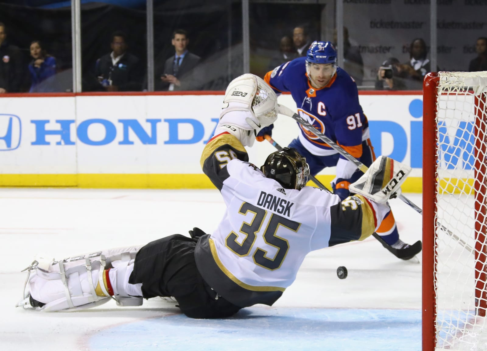 Oscar Dansk #35 of the Vegas Golden Knights blocks the net against John Tavares #91 of the New York Islanders.