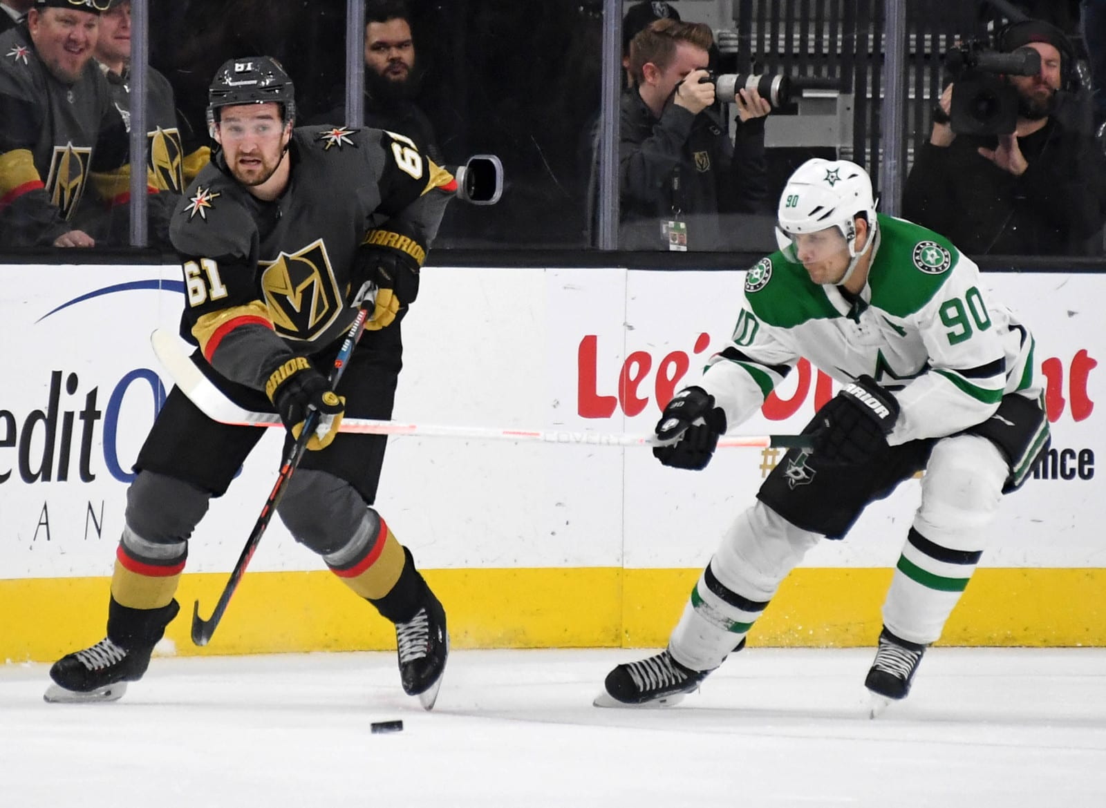 Mark Stone #61 of the Vegas Golden Knights passes the puck under pressure.