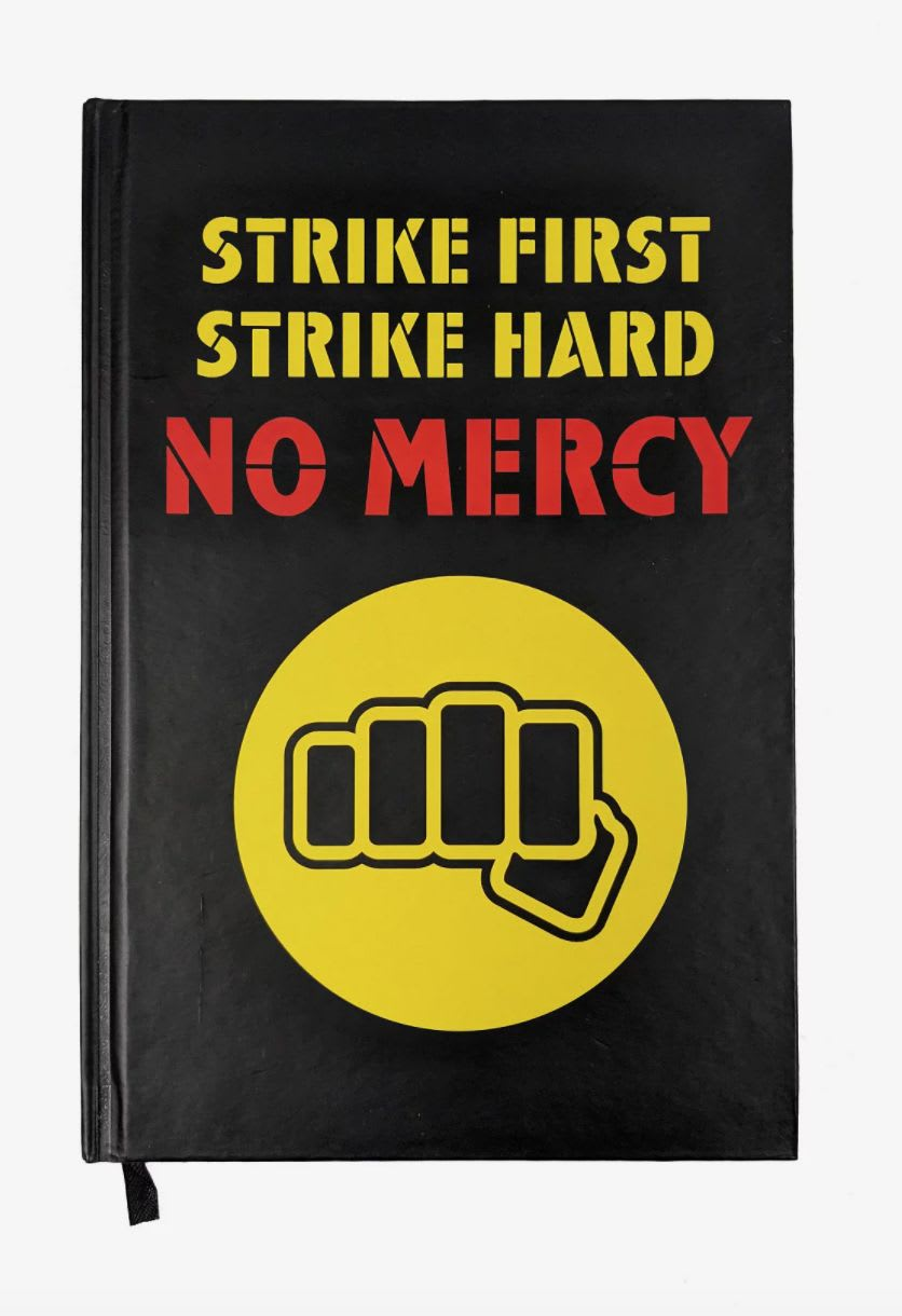 "Discover the 'Cobra Kai' ""Strike First. Strike Hard. No Mercy"" journal at Hot Topic."